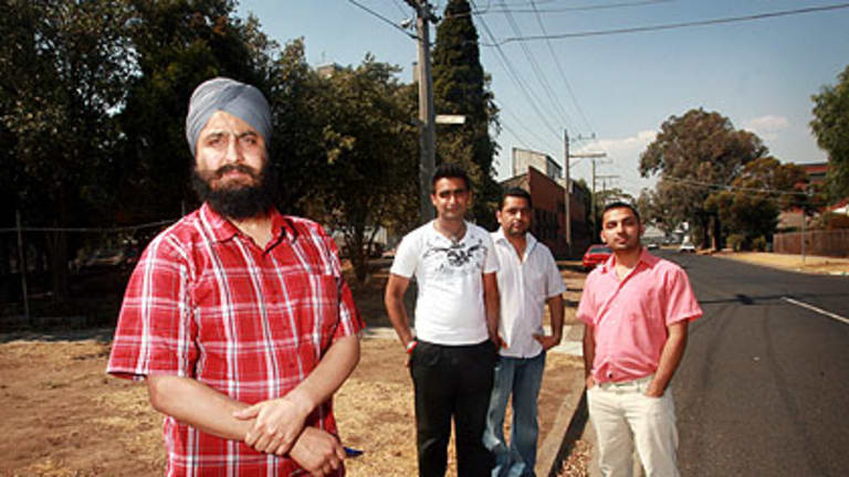 Dayajot Singh, foreground, stands on the corner of Barkly and Ferguson streets, with L to R, Inderjot Singh, Harwinder Singh and Ricky Ahluwalia.