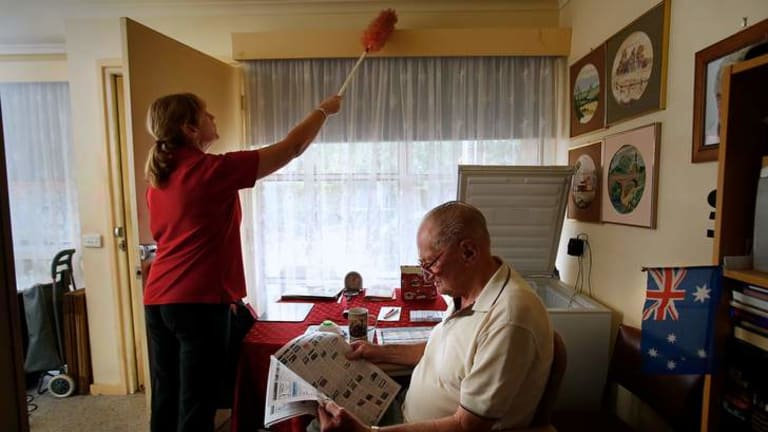 Here to help: Council worker Wendy Linn cleans the home of emphysema sufferer Brian McNeilly.