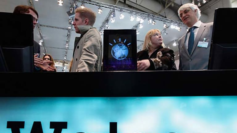 Visitors check out a slimmed down version of the IBM Watson supercomputer at the CeBIT technology fair in Hanover, Germany, on March 2, 2011.