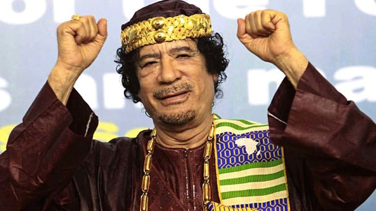 Always outspoken ...  Muammar Gaddafi gestures as he attends the Second Forum for Kings, Sultans, Princes, Sheikhs and Mayors of Africa in Tripoli in September 2010.