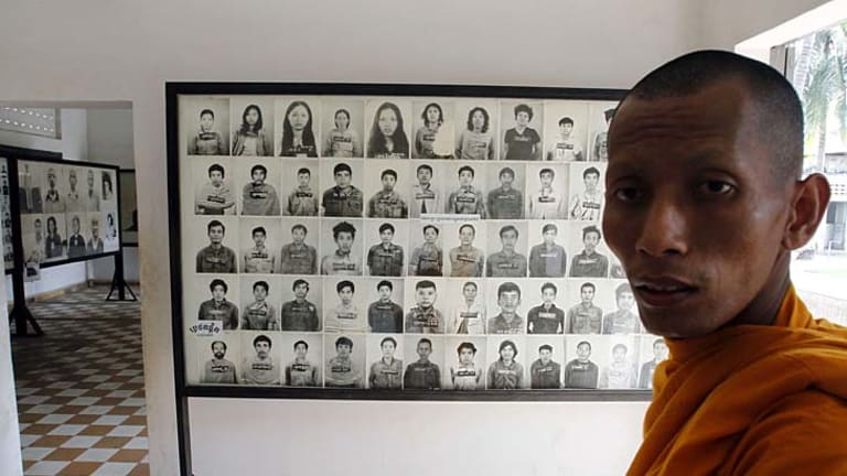 Faces of genocide: A Buddhist monk in the museum at the former Tuol Sleng prison where the Khmer Rouge held thousands of prisoners before sending them to their deaths.