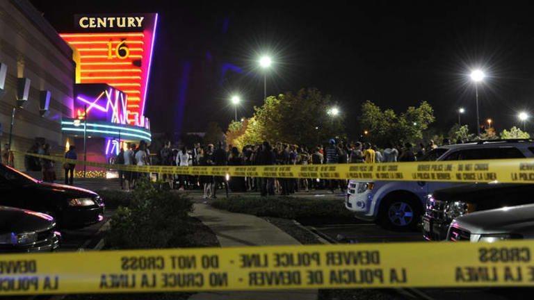 People gather outside the Century 16 movie theatre in Aurora, Colorado following the mass shooting.