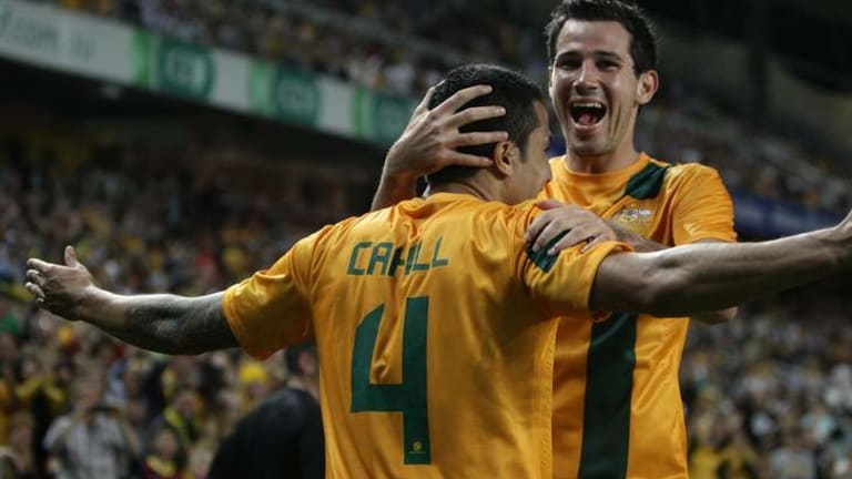 Milestone goal: Tim Cahill celebrates his goal with Ryan McGowan in Australia's 1-0 win over Costa Rica.