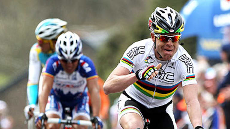 Cadel Evans races to victory in Belgium.