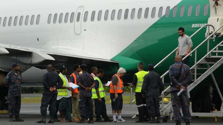 A drop in asylum seeker arrivals has seen less flights like this one to Australia's detention centre network.