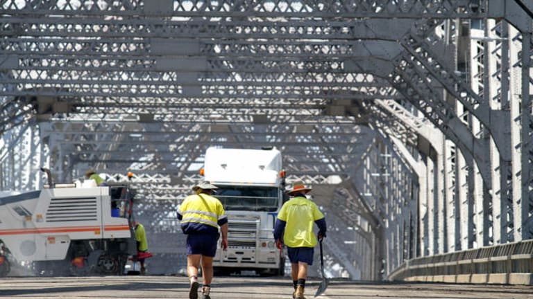 Brisbane City Council workers brave hot temperatures on the weekend to resurface the road on the Story Bridge. The bridge was last resurfaced 20 years ago.