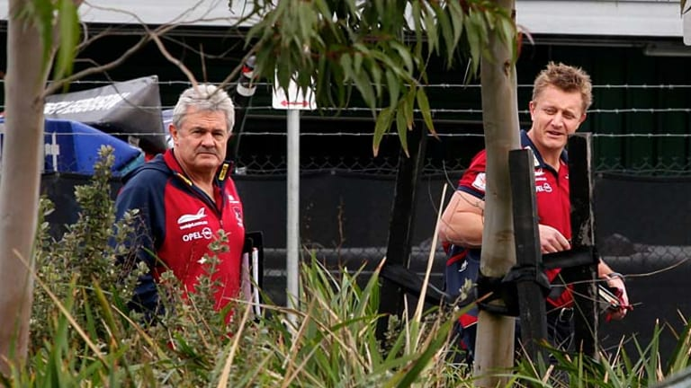 Coach Mark Neeld and football adminstrator Neil Craig arrive at the Melbourne board meeting Monday.