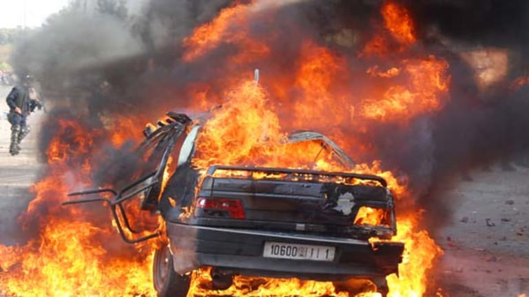 A car burns during a demonstration in Marrakesh.