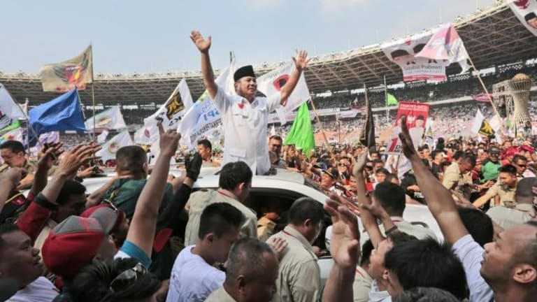 Indonesian presidential candidate Prabowo Subianto greets his supporters during a rally at Gelora Bung Karno Stadium in Jakarta on Sunday.