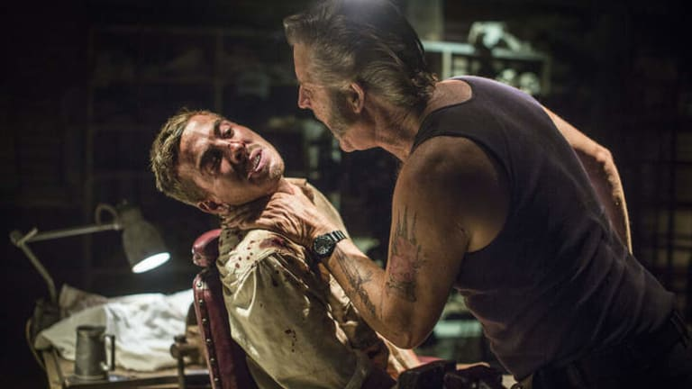 Captive audience: arch villain Mick Taylor (John Jarratt) gives his unsuspecting backpack prisoner a piece of his mind in <i>Wolf Creek 2</i>.