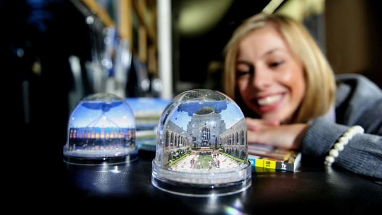 The Canberra and Region Visitors Centre, Dickson says some of its most popular souvenir items are, snow domes, hats, postcards and maps.