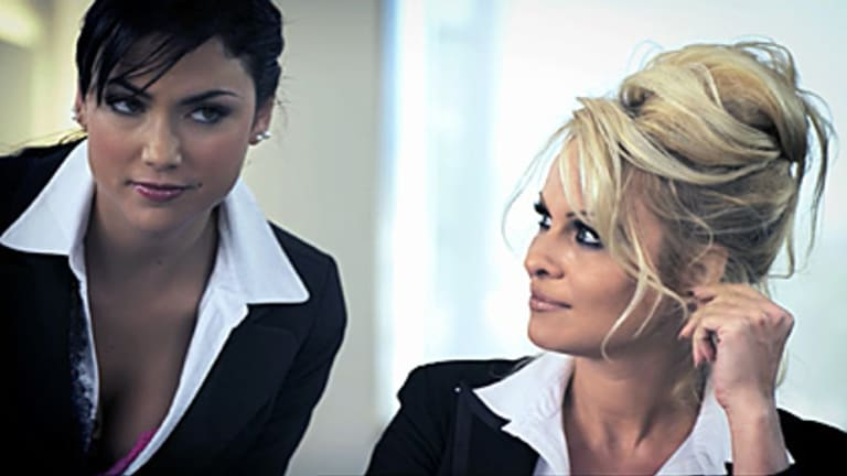"Pamela Anderson and her ""assistant"" in a shot from the original offending advert."