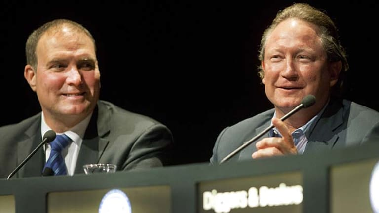 Andrew Forrest (right), flanked by Fortescue chief executive Neville Power, speaks at the conference yesterday.
