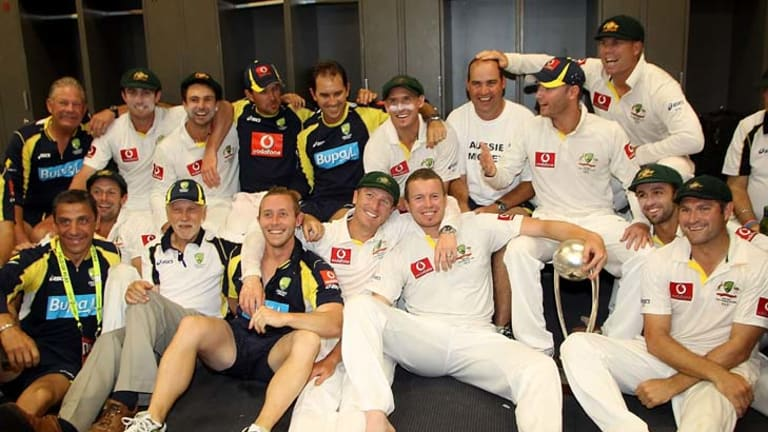 Job well done … the Australian players and staff celebrate yesterday after the team won the fourth Test of the Border-Gavaskar series.