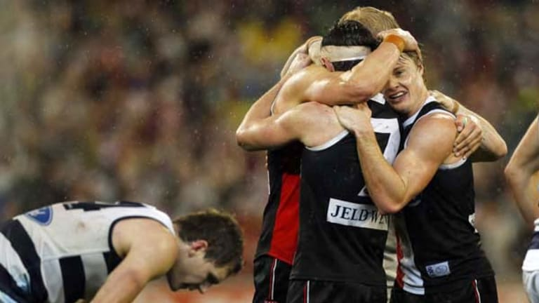 Saints captain Nick Riewoldt celebrates with vice-captain Lenny Hayes and tagger Clinton Jones after St Kilda held on to defeat Geelong. On the left is an exhausted Joel Selwood.