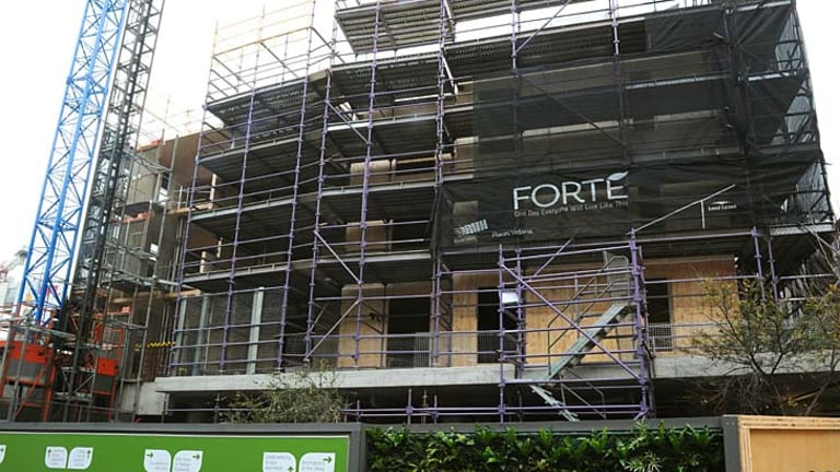 Leading the way: work proceeds on the Forte timber apartment building at Docklands.