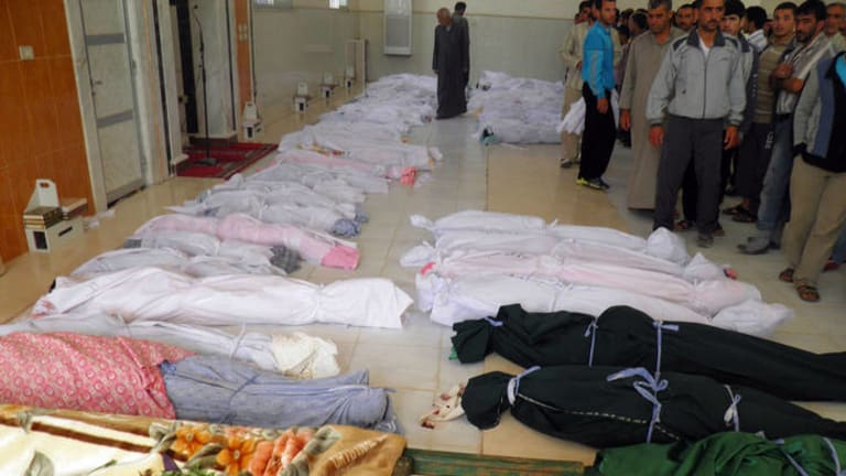 A handout picture released by the Syrian opposition's Shaam News Network shows the bodies of 92 people including 32 children before their burial in the central Syrian town of Houla on May 26, 2012.