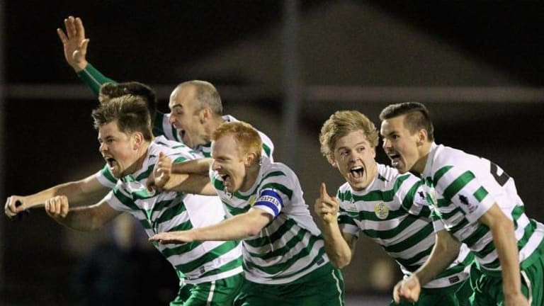 You beauty! Tuggeranong players celebrate their penalty shootout win over South Hobart in the FFA Cup.