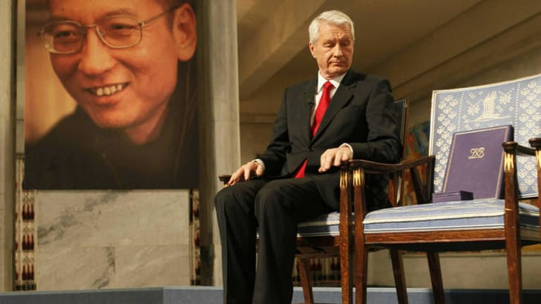 Norwegian Nobel Committee Chairman Thorbjoern Jagland sits next to empty chair during the ceremony to honour prize winner Liu Xiaobo in 2010.
