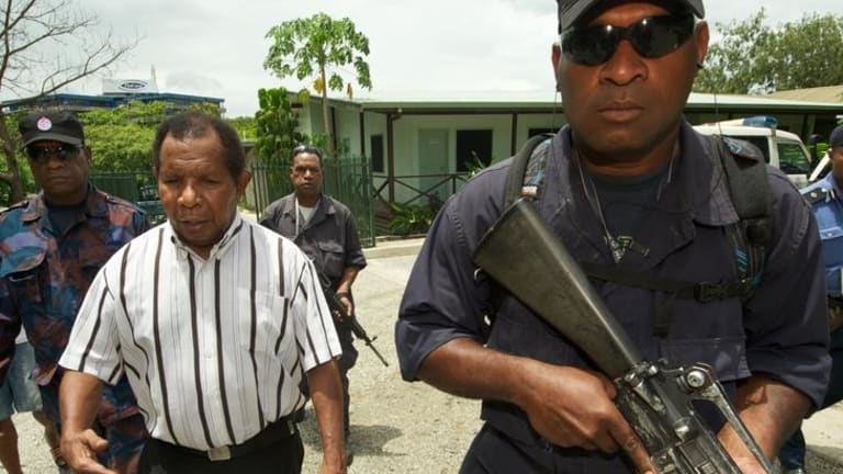 Failed coup leader, retired colonel Yaura Sasa under arrest at the Waigani District court in Port Moresby.