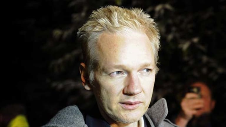 WikiLeaks founder Julian Assange speaks to the media outside Ellingham Hall in Norfolk, England, the home of his friend, journalist Vaughan Smith.