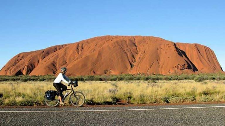 Frederike Moodie rides in central Australia, with Uluru a familiar backdrop.