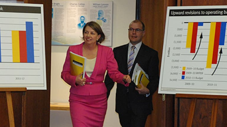In the pink ... Premier Anna Bligh and Treasurer Andrew Fraser arrive to deliver the state budget this morning.