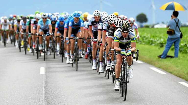 Leadership role: Confessed doper Stuart O'Grady, seen here leading the peloton at last year's Tour de France, could help educate Olympians.