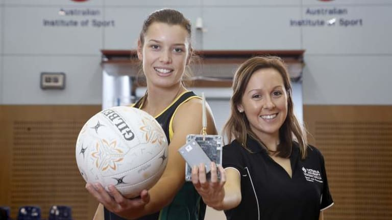 Sport,  from left, U-21 World Youth Squad member Micaela Wilson and Victoria University PHD student Alice Sweeting with a RF tracking system at AIS.