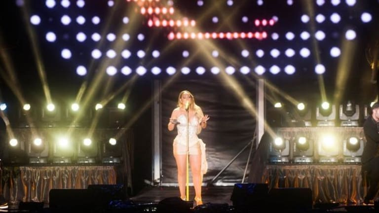 Mariah Carey opened her Australian tour with a rain-soaked performance at Sandalford on Saturday night.