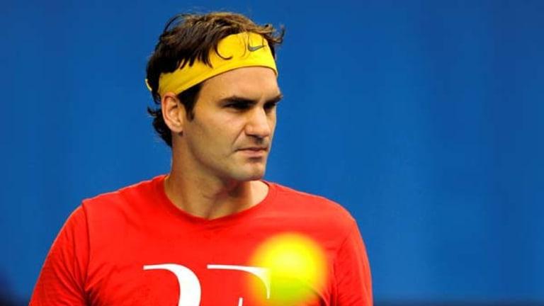 Roger Federer practising at Rod Laver Arena yesterday.