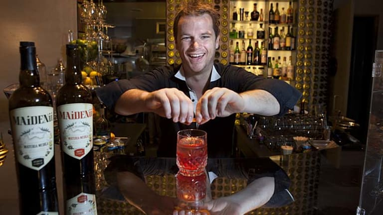 Shaun Byrne mixes up a cocktail at Bar Ampere in Russell Place. He has collaborated with French winemaker Gilles Lapulus to produce Maidenii Vermouth, using Australian native plants.