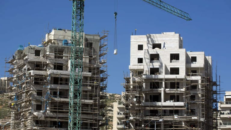 Labourers work at a housing construction site in the Israeli settlement of Har Homa in east Jerusalem.