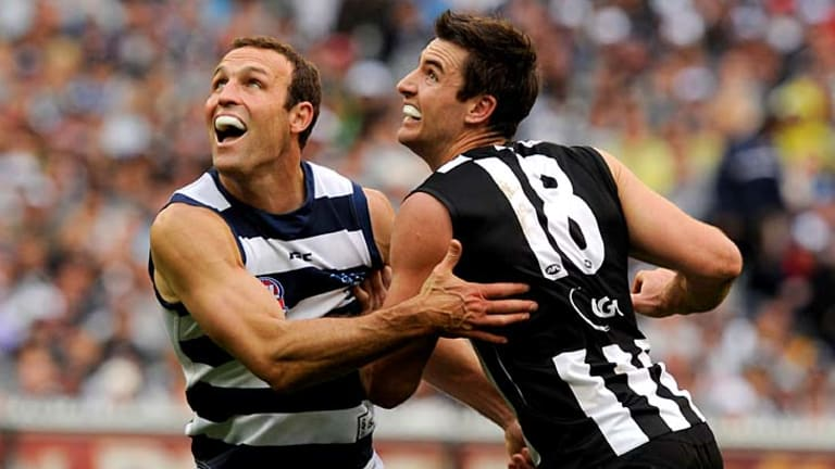 Geelong's Brad Ottens battles with Collingwood's Darren Jolly during the 2011 grand final.