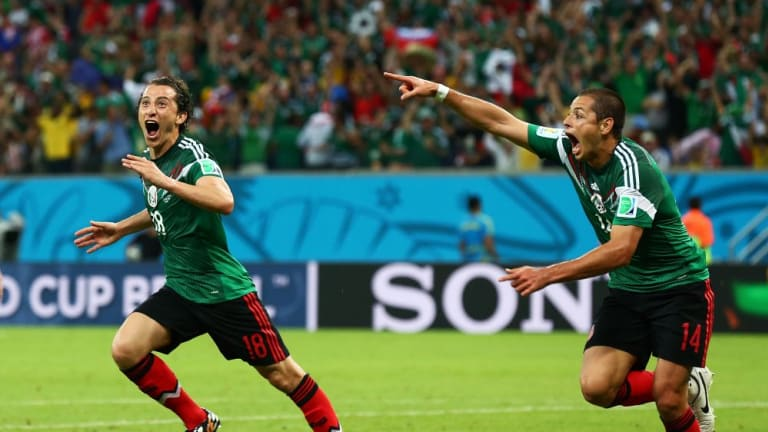 Andres Guardado  (left)  and Javier Hernandez of Mexico celebrate their team's second goal against Croatia.