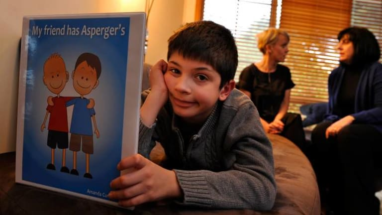 Turning his world around: Robert, 9, who has Asperger's syndrome, with (back centre) author Amanda Curtis and his mother, Letizia Faba.