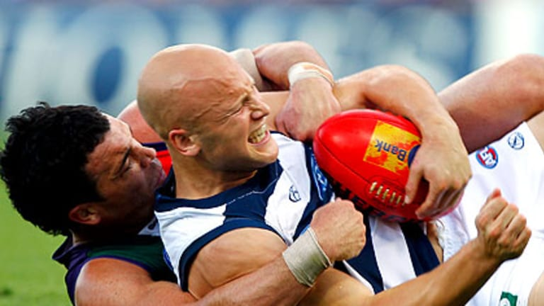 Fremantle's Ryan Crowley comes to grips with Gary Ablett in round three at Subiaco Oval. The Dockers won't be allowing Ablett much space at the MCG tonight.