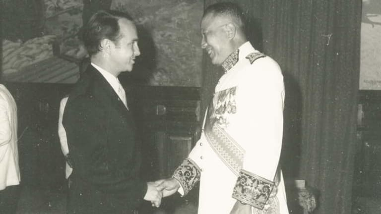 Deeply committed civil servant: Peter Curtis greets the last King of Laos, Sisavang Vatthana. Everywhere he was, he never forgot why he was there - to do good for Australia.