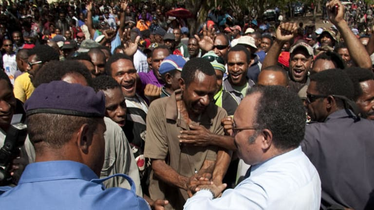 Peter O'Neill greets supporters in Port Moresby.