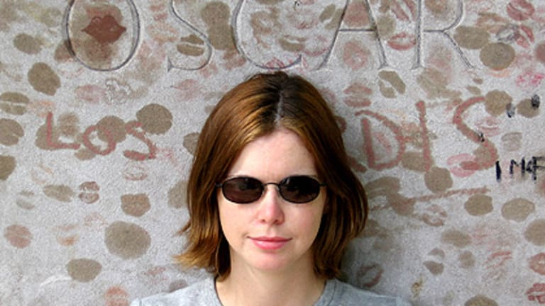 Writer Angelique Flowers, who died from cancer last month, at Oscar Wilde's grave at Pere Lachaise cemetery in Paris in 2006.