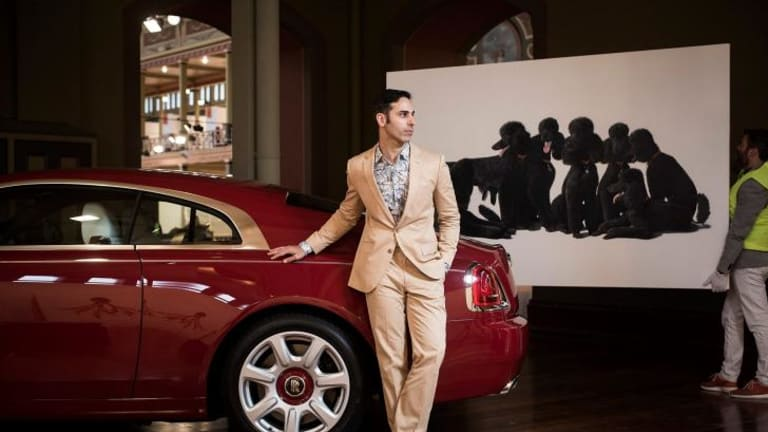 Artist Michael Zavros with his work <i>A Rolls-Royce</i> at the Melbourne Art Fair.