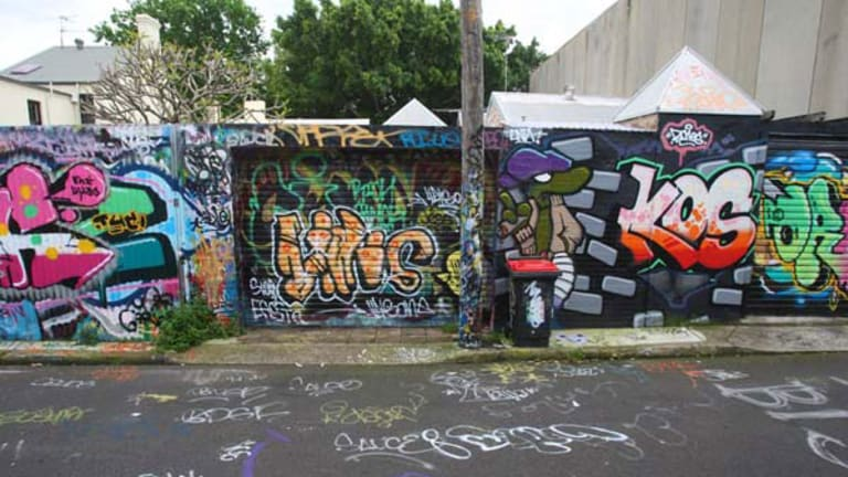 """Ugly """"tags"""", above, are an unwanted byproduct of the legal art in May Lane, say  residents, who are calling on the council to act against the vandals."""