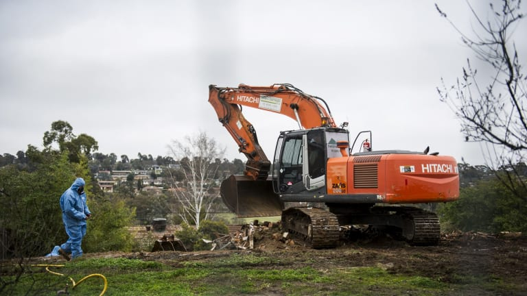 Say goodbye: Workers demolish a Mr Fluffy home in Woden on Tuesday morning.