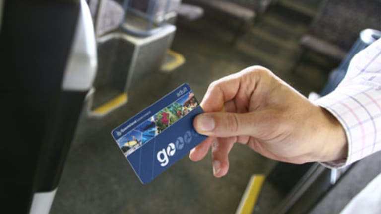 A traveller uses a Go Card to access transport in Queensland.