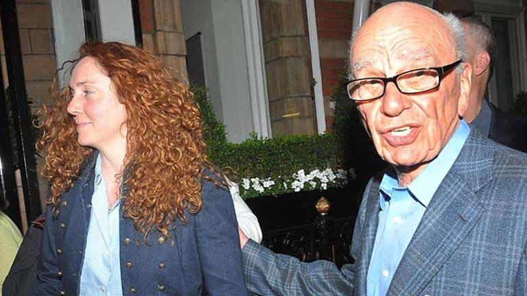 Rupert Murdoch, pictured outside his London home with Rebekah Brooks.