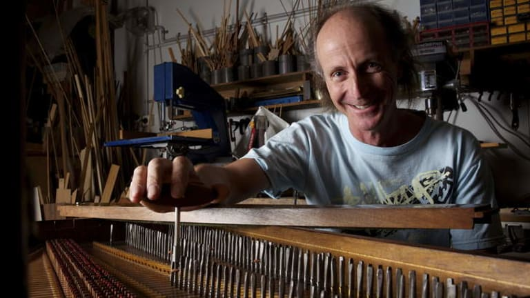 Fine tuning: Harpsichord maker Carey Beebe with the restored 1773 instrument which will be played in concert on Saturday.