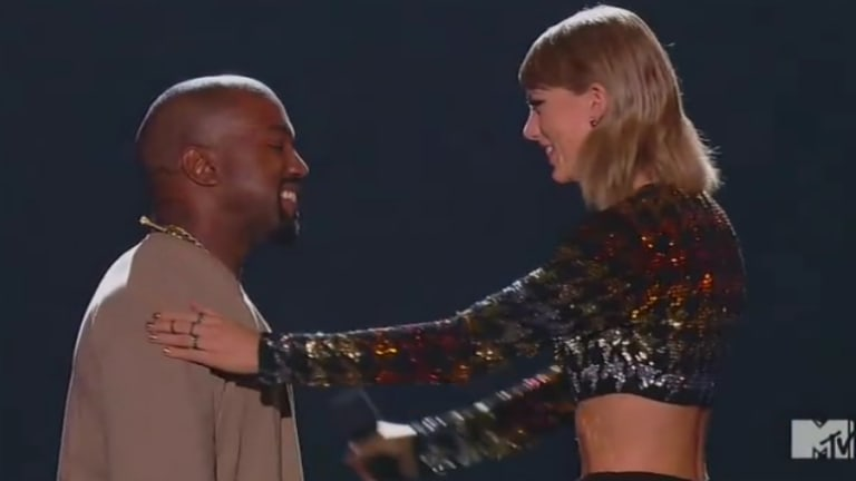 Taylor Swift presented Kanye West with the Video Vanguard award.