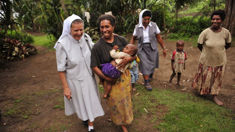 Sister Rose Bernard (left) in a village in Banz.