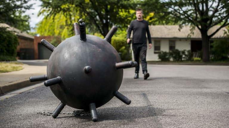 EXPLOSIVE: Stephen Harrison, above, preparing the sculpture exhibition in Downer.