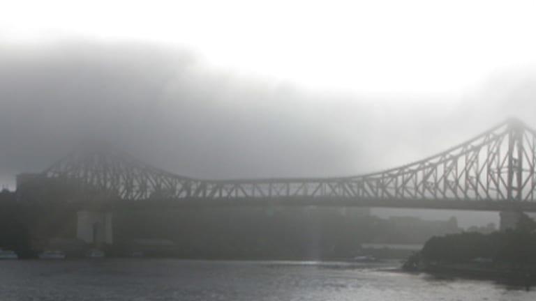 Fog envelops Brisbane's Story Bridge this morning.